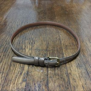 Coach tan leather belt. Made of cowhide and brass